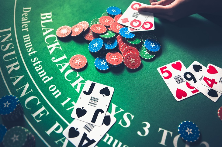 Blackjack Table With Cards and Casino Chips