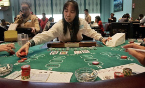 Chinese baccarat dealer