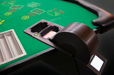 iDEAL automatic shuffler installed on a Three Card Poker table
