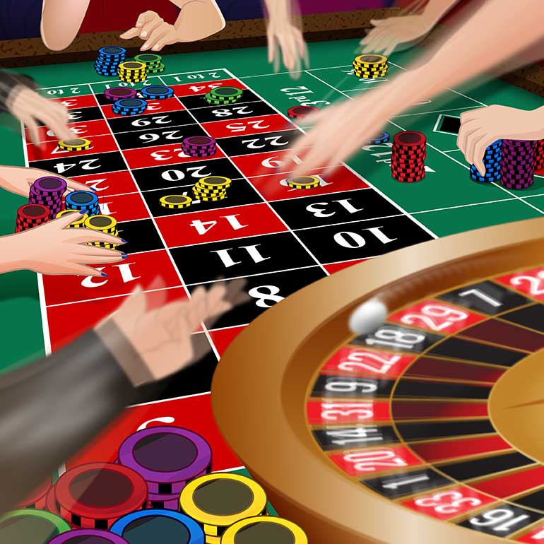 Roulette players placing their bets