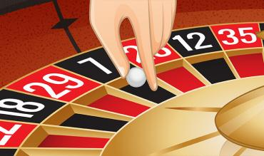Roulette Croupier holding the roulette ball